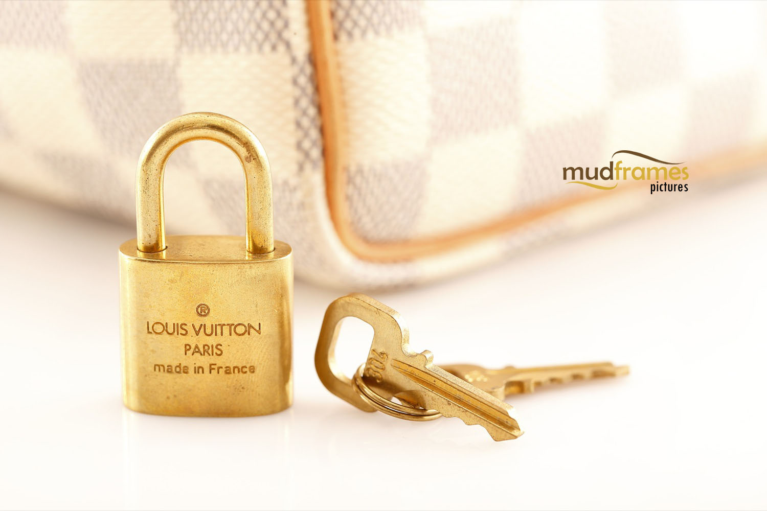 Louis Vuitton key lock on white background