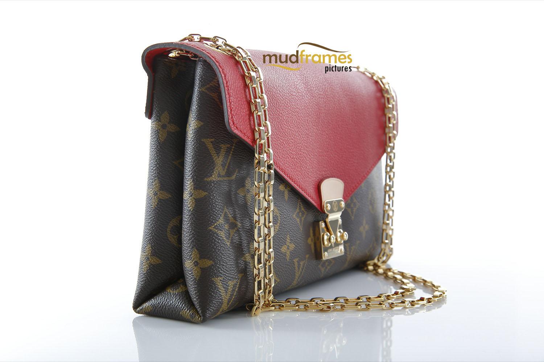 Louis Vuitton bag on white background