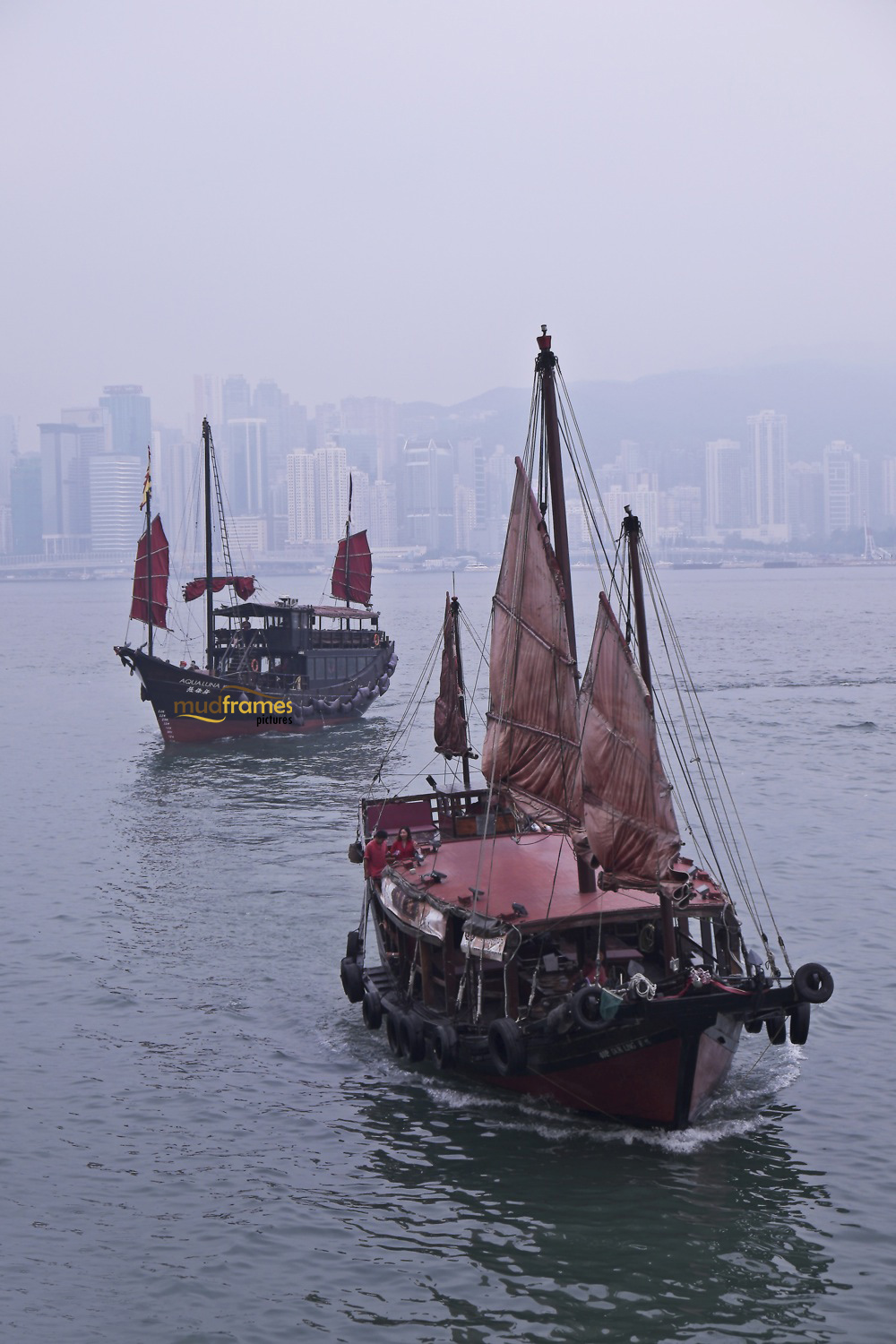 Junk against Hong Kong island as backdrop