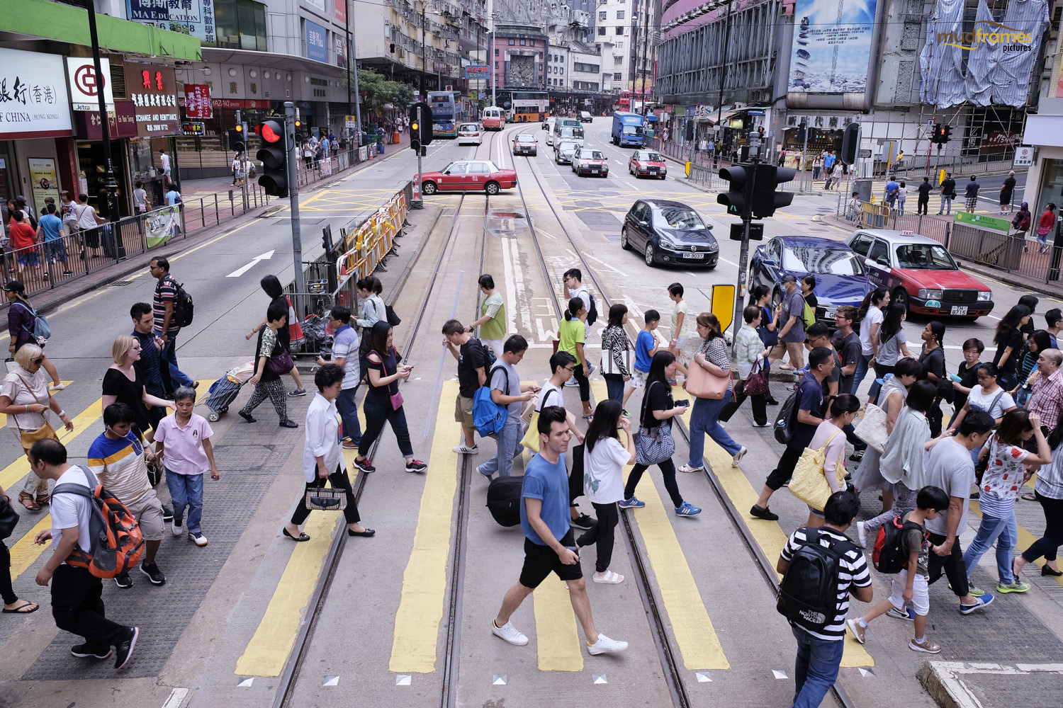 People crossing busy street at Hong Kong
